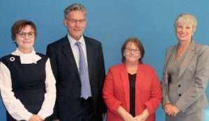 pictured L to R: Moira Gibb, Chair of the Skills for Care Board, Aston OD's Michael West and Lynn Markiewicz, and Sharon Allen, Chief Executive, Skills for Care